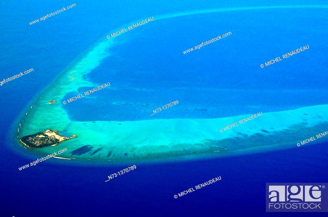 Stock Photo: Indian Ocean, Maldives, Atoll and Island from the sky.