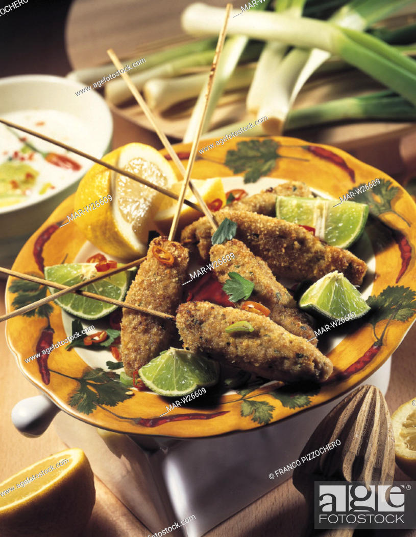 Stock Photo: skewers of chicken with lemon and lime.
