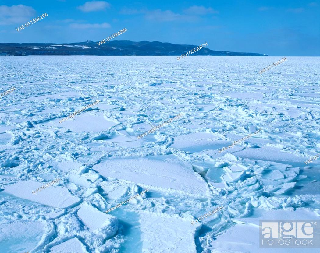 Stock Photo: Ice Floes Near Hills.