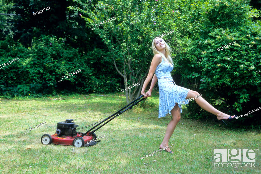 Woman Mowing Lawn Stock Images, Royalty-Free Images