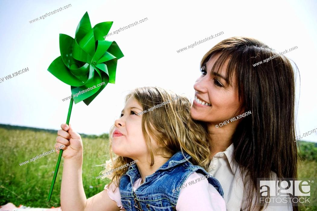 Stock Photo: Woman and girl with toy windmill.