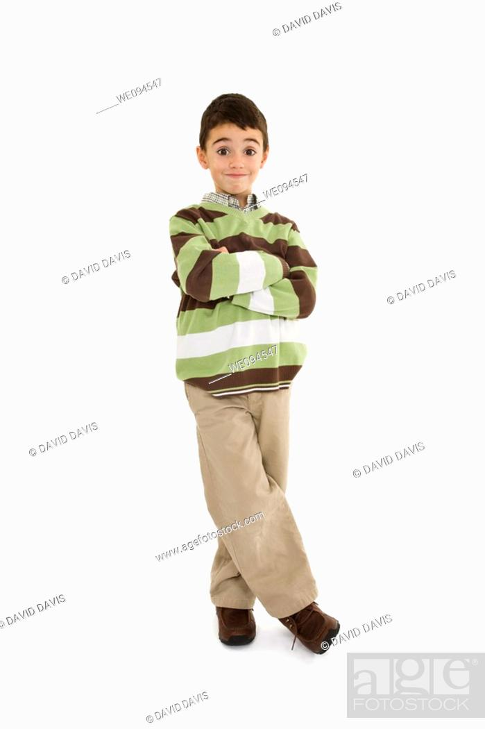 Stock Photo: Young caucasian boy dressed in a casual outfit and standing on a white background.