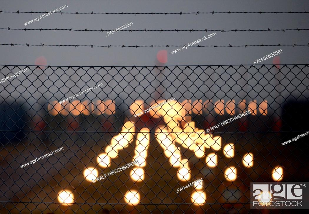 Approach lights on the northern runway are lit behind a