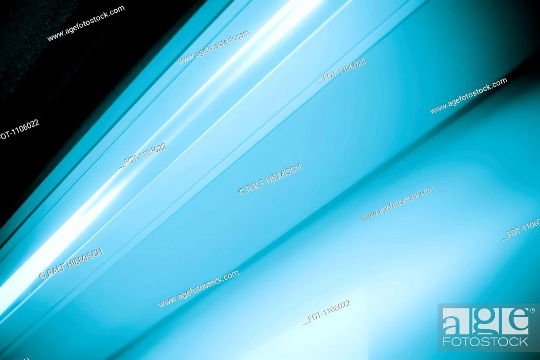 Stock Photo: Close-up abstract of slanted blue shape.