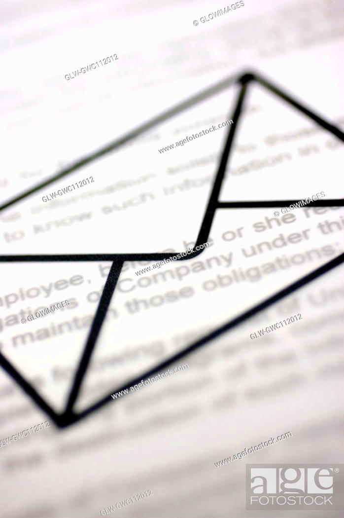 Stock Photo: Close-up of an envelope sign over a document.