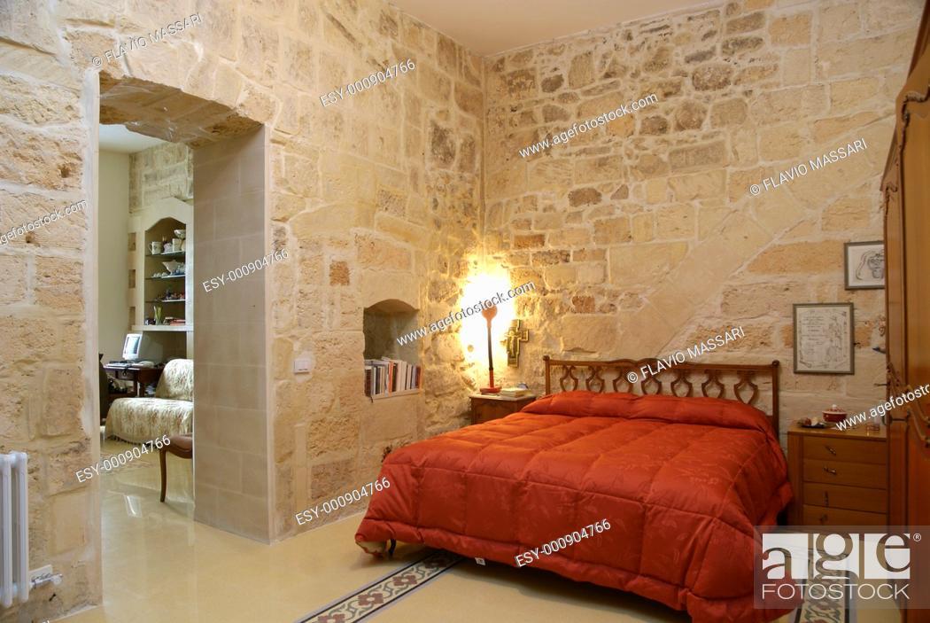 Stock Photo: warm rustic bedroom.