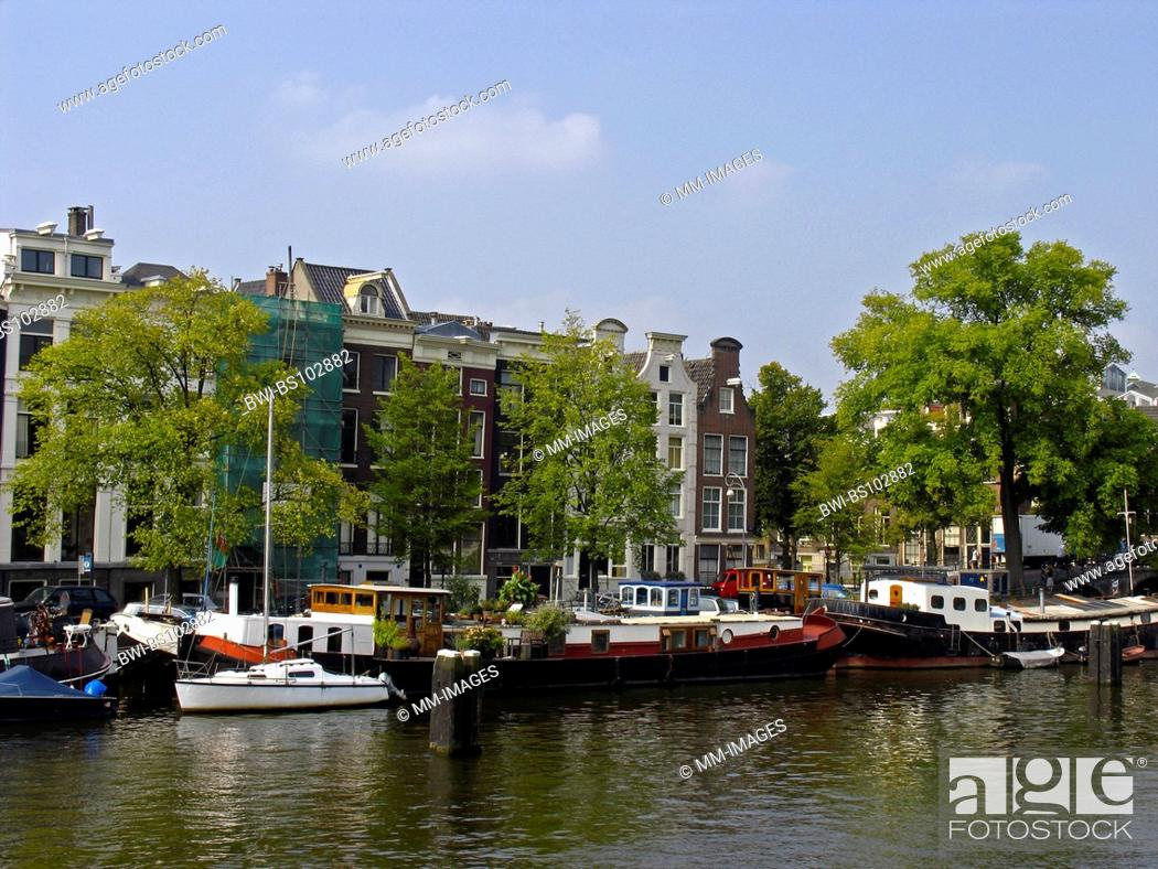 Stock Photo: the river Amstel with old canal houses and houseboats, Netherlands.