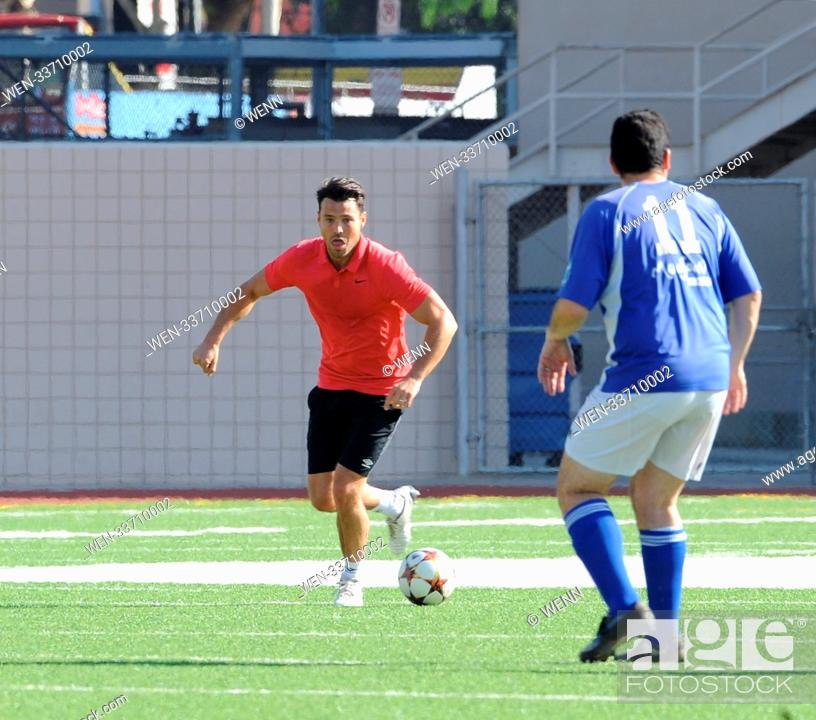Mark Wright shows off his soccer moves while palying a friendly