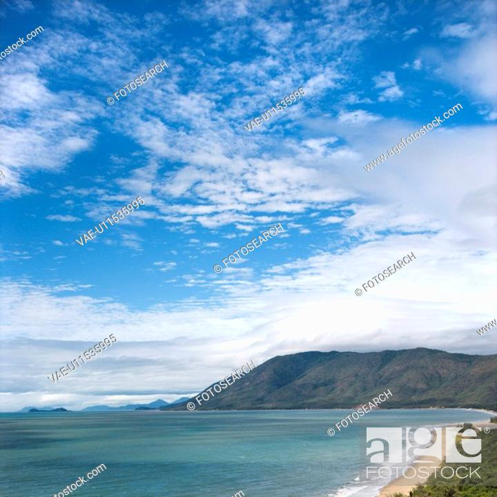 Stock Photo: Scenic coastal view from Queensland Rex Lookout with mountains in background under blue sky with clouds.