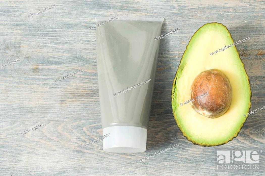 Stock Photo: Tube of face mask and avocado.
