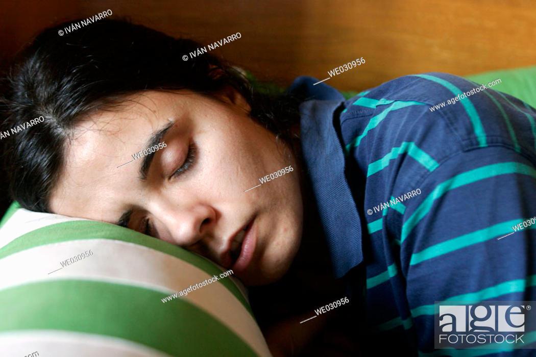 Stock Photo: Young woman sleeping.
