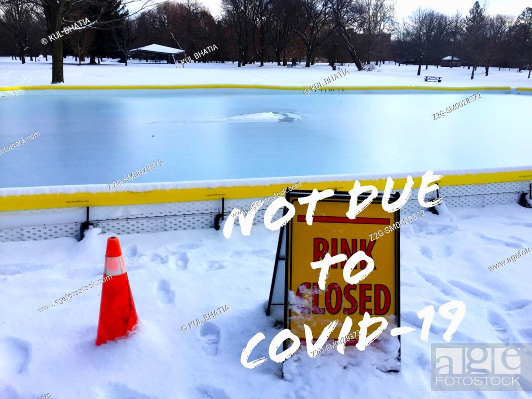 Stock Photo: Open air skating rink, surrounded by fresh snow, closed but not due to Covid-19, in a park, Ontario.
