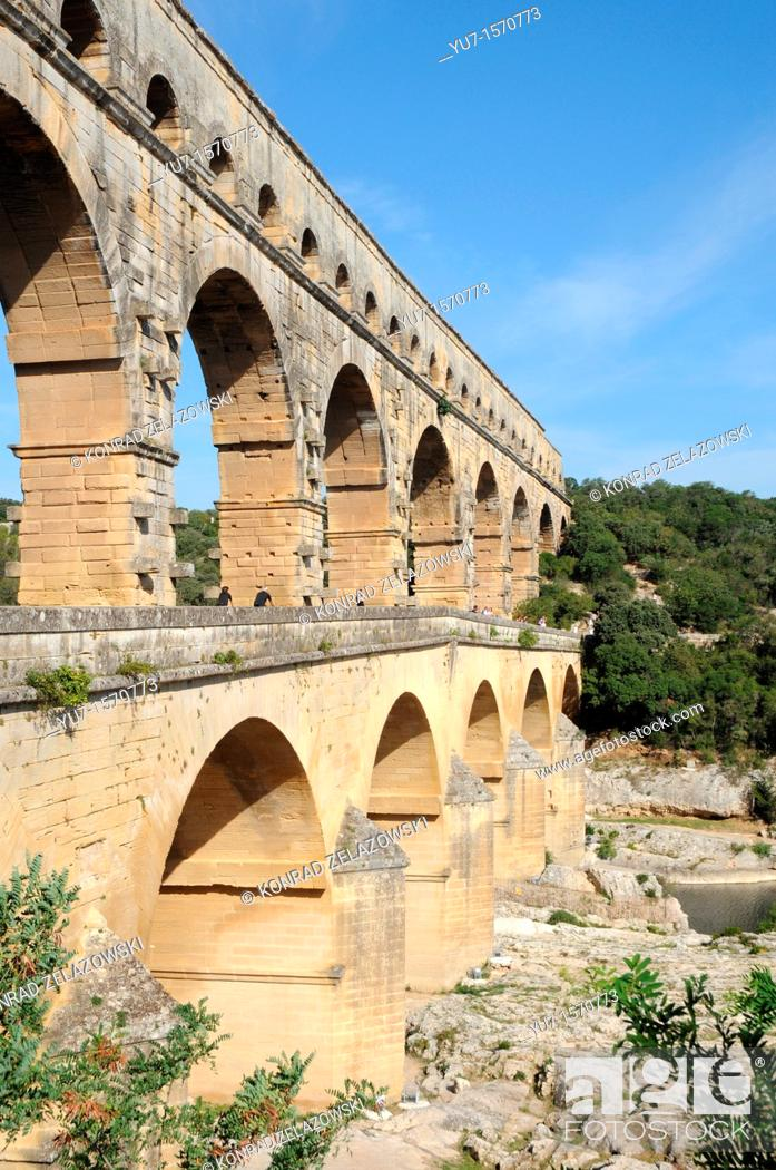 Stock Photo: Ancient Roman aqueduct bridge from 1st century AD called Pont du Gard over Gard River near Remoulins, Gard departement in France.