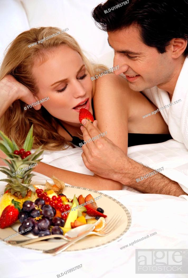Stock Photo: Couple relaxing in bed.