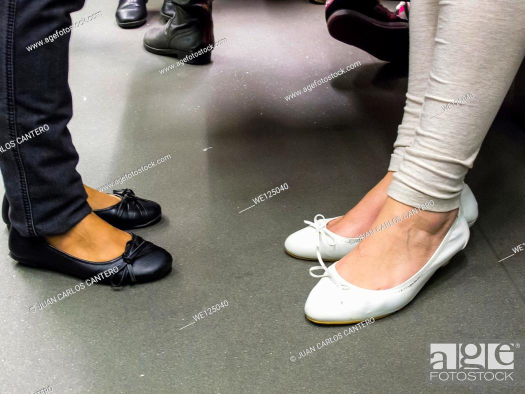Stock Photo: Detail of shoes in the Bilbao metro. Vizcaya. Basque Country. Spain.
