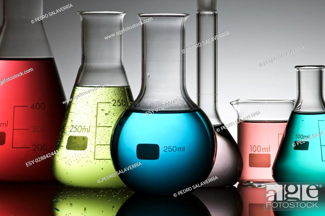 Stock Photo: group of laboratory flasks with liquid inside.