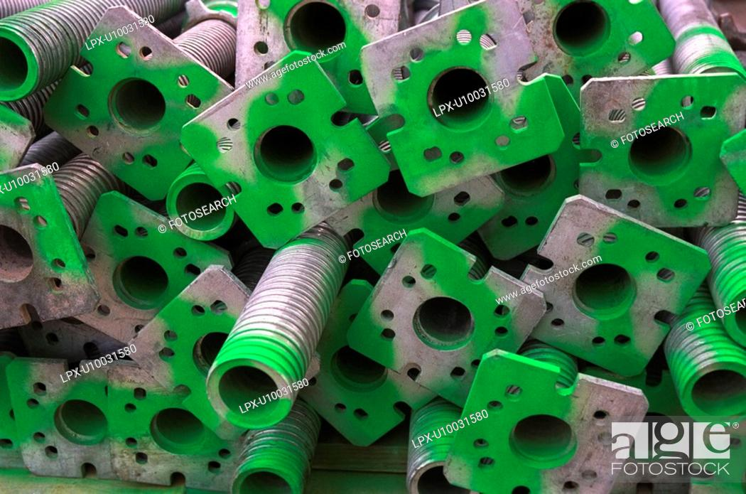 Stock Photo: Stockpile of scaffolding components.