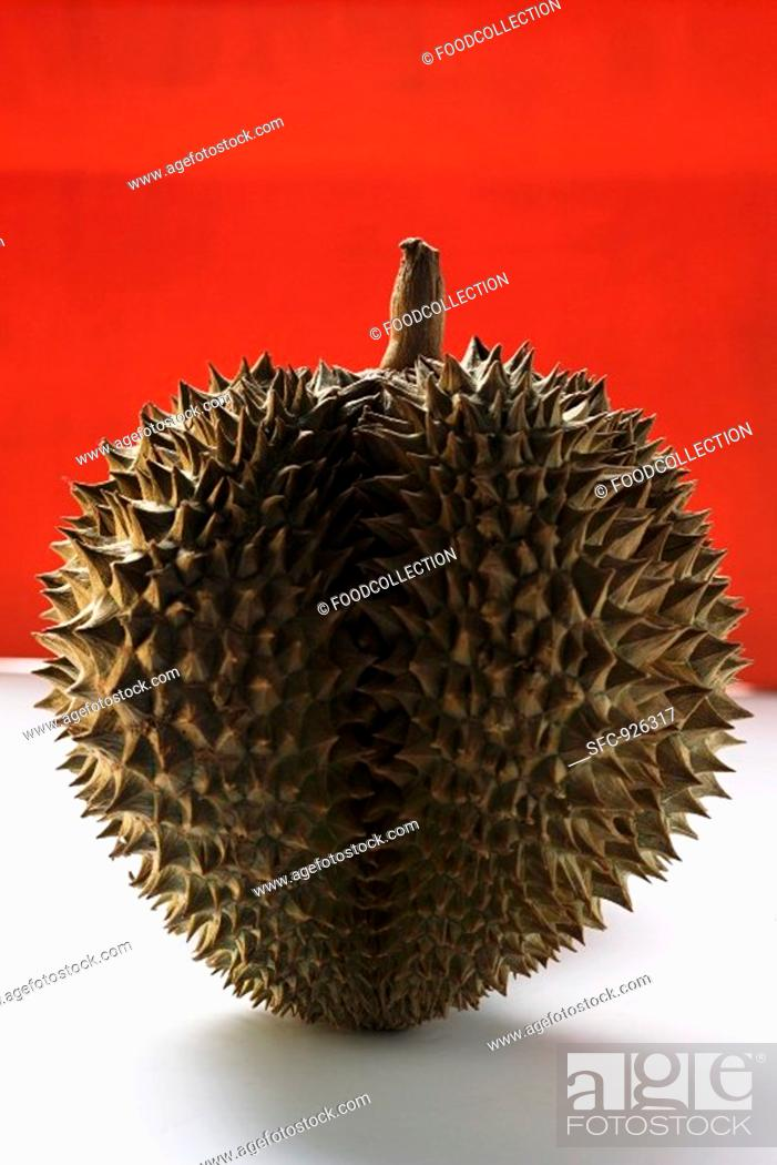 Stock Photo: Durian on red and white background.