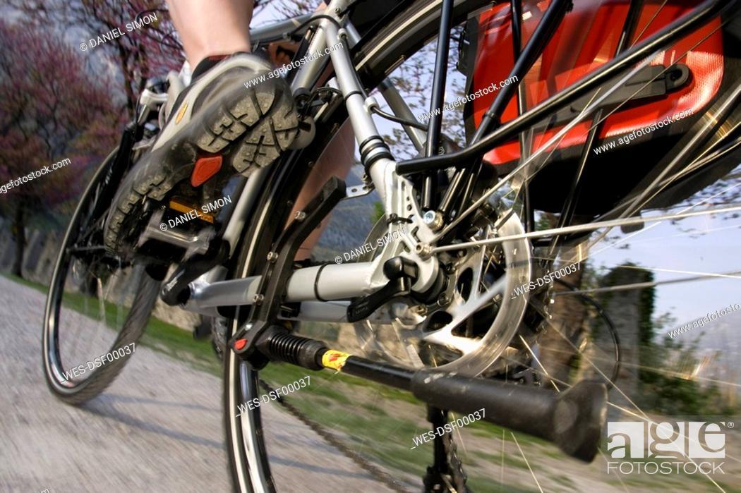 Stock Photo: Italy, Trento, Person mountain biking, low angle view.