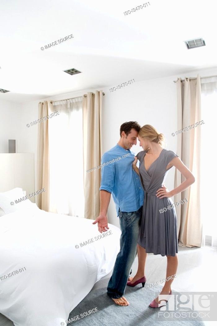 Stock Photo: Woman grabbing man in the bedroom.