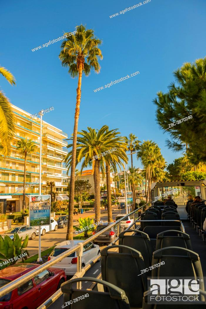 Stock Photo: Roof view from a convertible bus in a Sunny Say over Cannes in Provence-Alpes-Côte d'Azur, France.