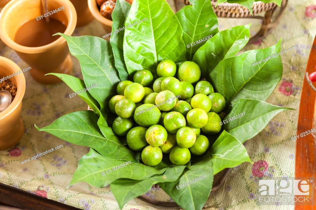 Stock Photo: Fresh limes surrounded by leaves, Bangkok, Thailand.