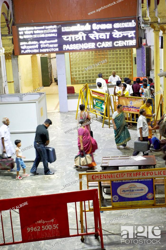 Stock Photo: Cheenai, India - April 28, 2010: large number of travelers waiting seated in the main departure waiting wall of Cennai Central Railways station.