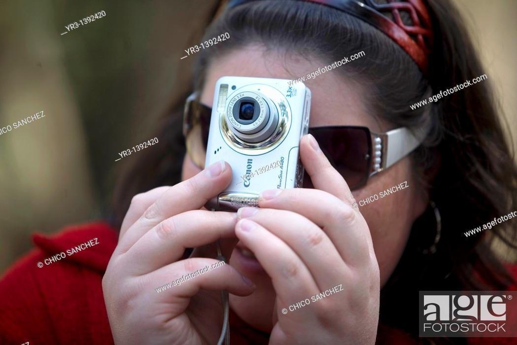 Stock Photo: A blind student takes a picture.