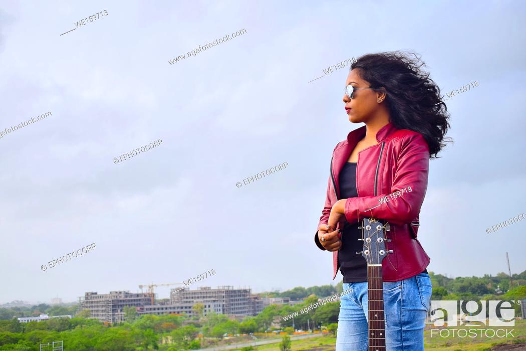 Stock Photo: Young Indian girl with guitar, Pune, Maharashtra.