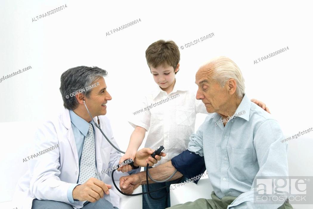 Stock Photo: Doctor measuring senior man's blood pressure, boy helping.