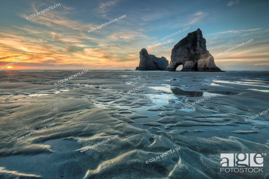 Stock Photo: Archway Islands, sunset, Wharariki beach, near Collingwood, Golden Bay, New Zealand.
