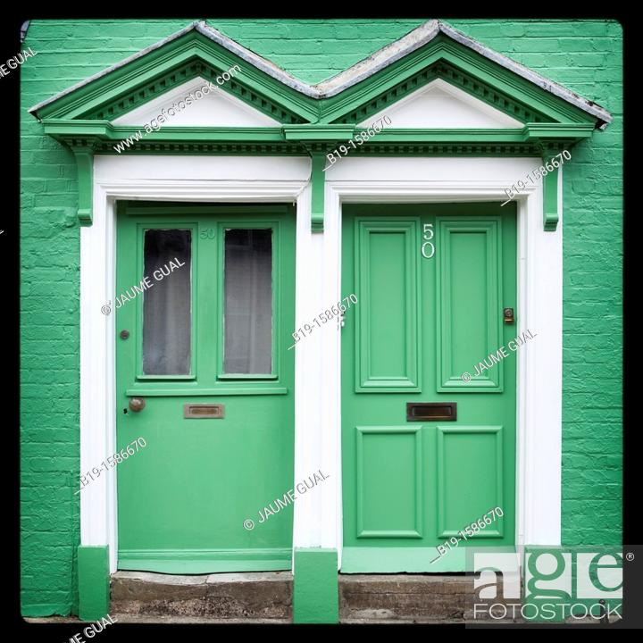 Stock Photo: Two gren doors in a green wall, Arundel, England, Europe.