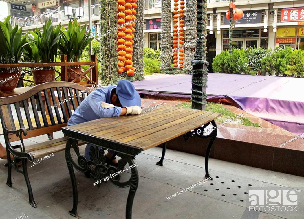 Stock Photo: Cleaning employee napping in Shanghai. China.