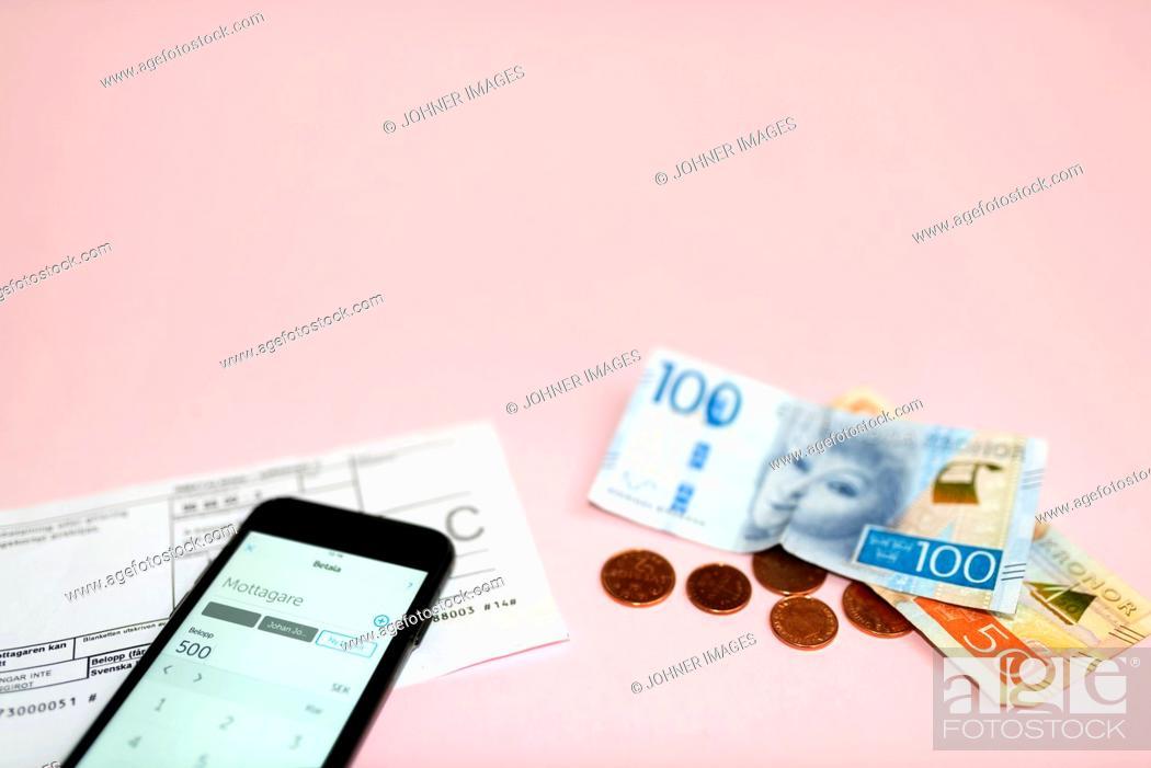 Stock Photo: Smartphone and money.