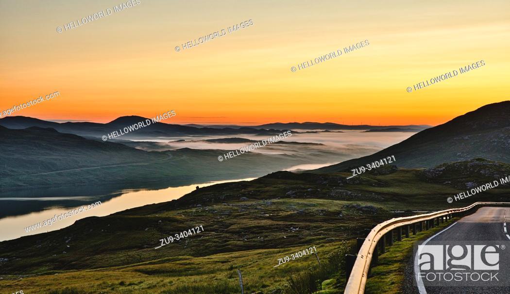 Imagen: Orange sky golden hour summer sunrise misty landscape, Isle of Lewis, Outer Hebrides, Scotland.