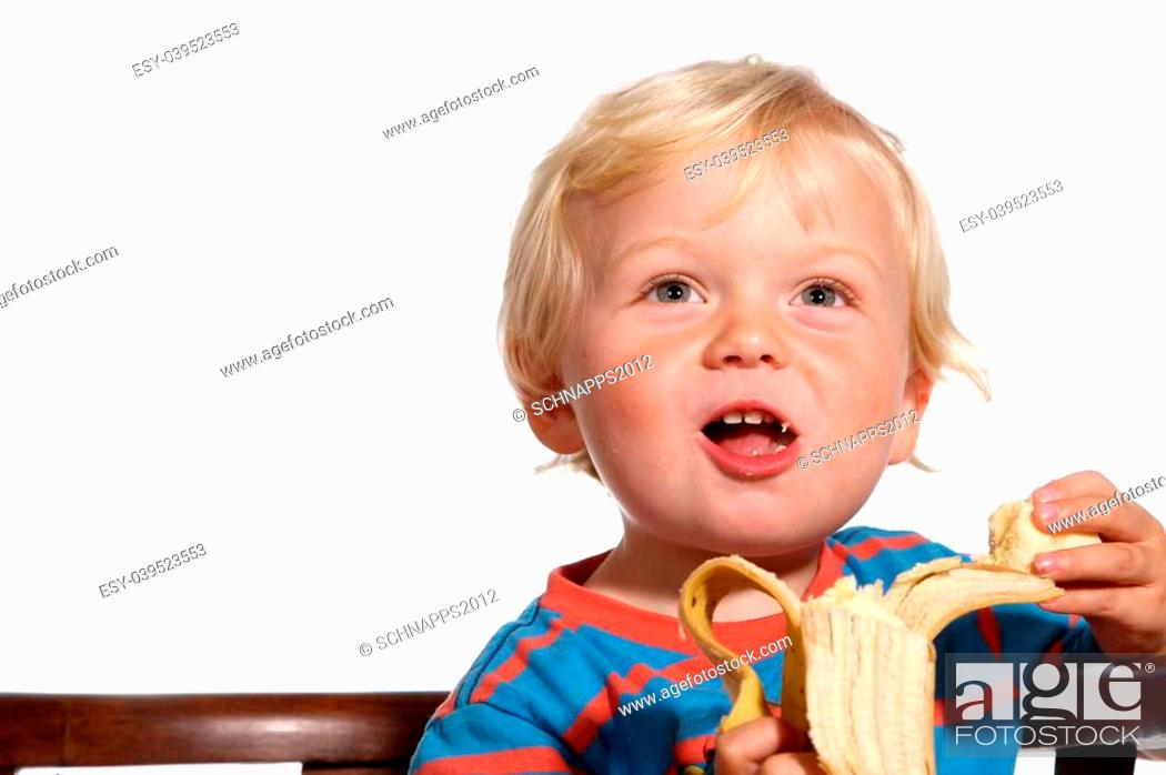 Stock Photo: Two year old blond boy posing on a white background.