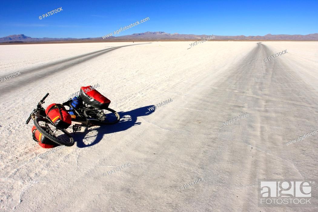 Stock Photo: A bicycle lying on the frozen salt lake called 'Salar de Uyuni' in Bolivia.