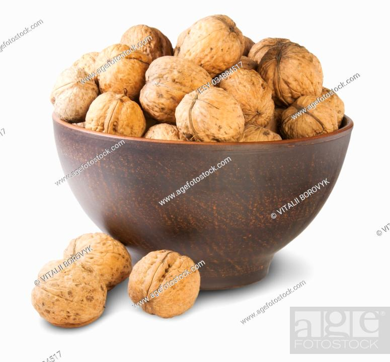 Stock Photo: Walnuts In A Clay Bowl Isolated On White Background.