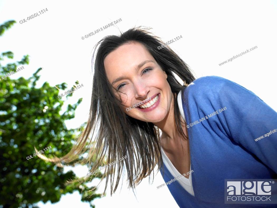 Stock Photo: Woman smiling, portrait.