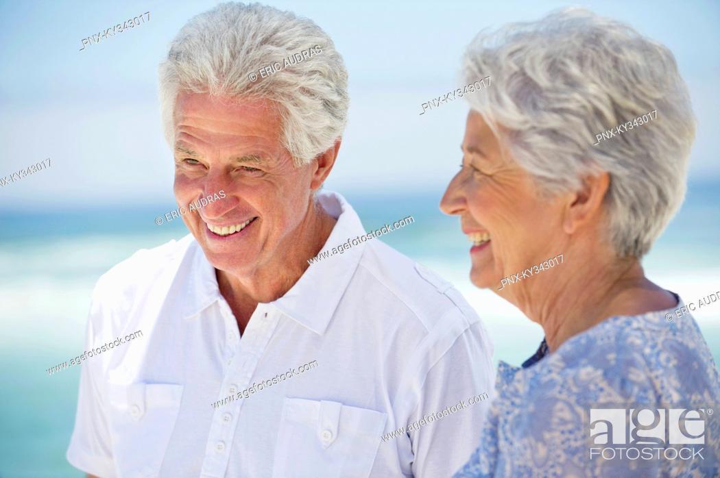 Stock Photo: Happy senior couple on the beach.