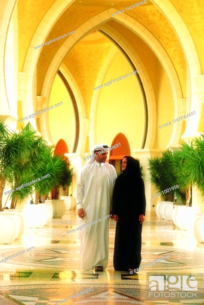Stock Photo: Arab couple walking down a passage.