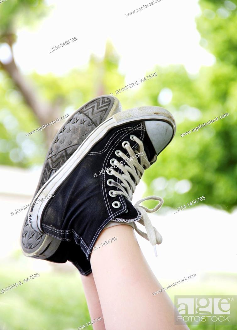 Stock Photo: A boys tennis shoes.