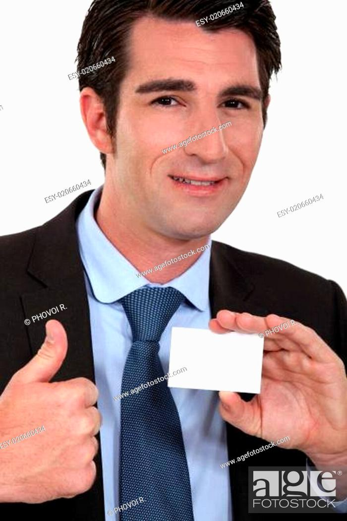 Stock Photo: Man giving ok gesture whilst holding business card.