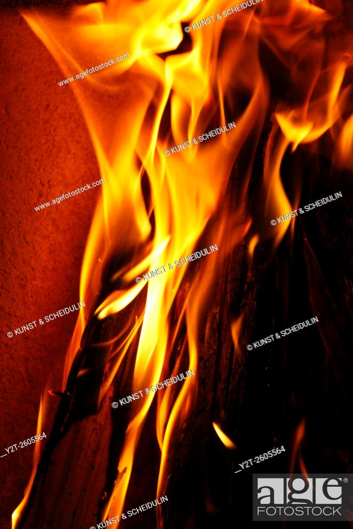 Stock Photo: Logs are burning in a fireplace.