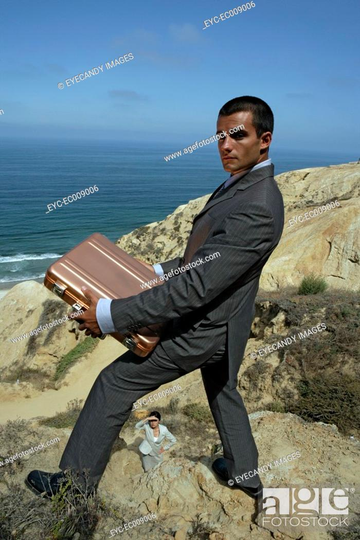 Stock Photo: View of a man holding a briefcase.