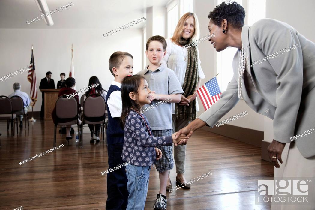 Stock Photo: Politician greeting children at political gathering.