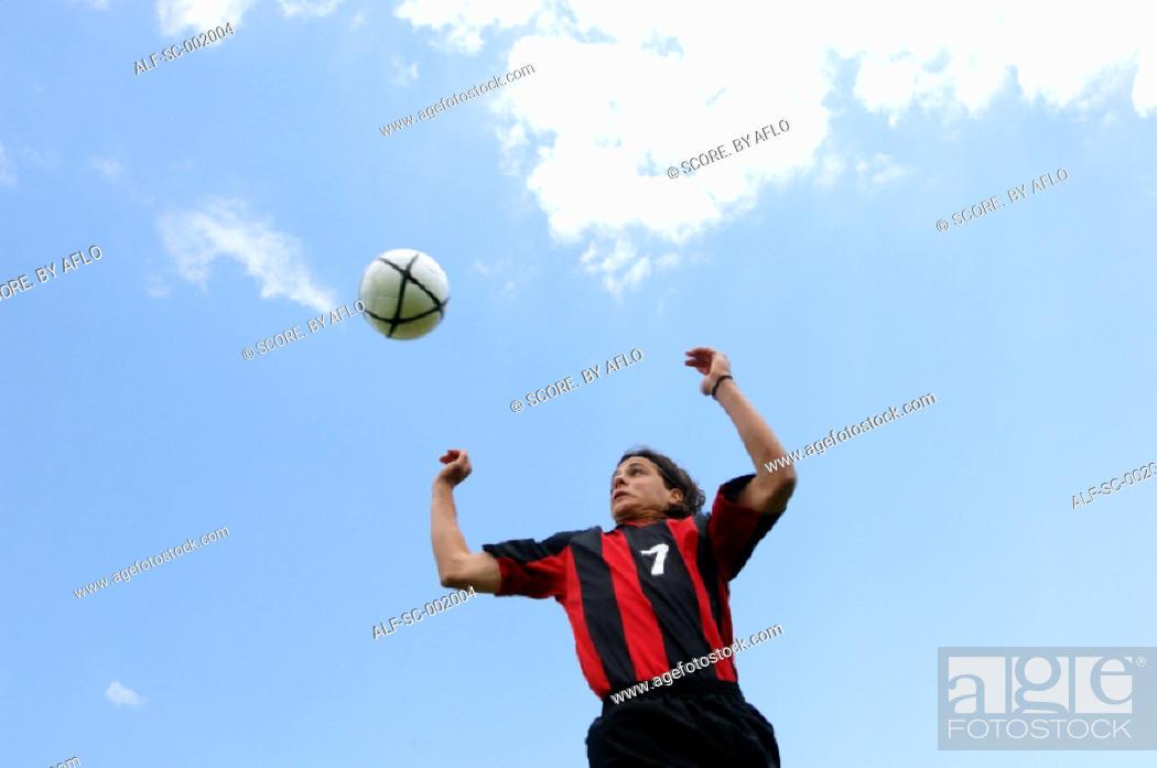 Stock Photo: Soccer player heading ball.