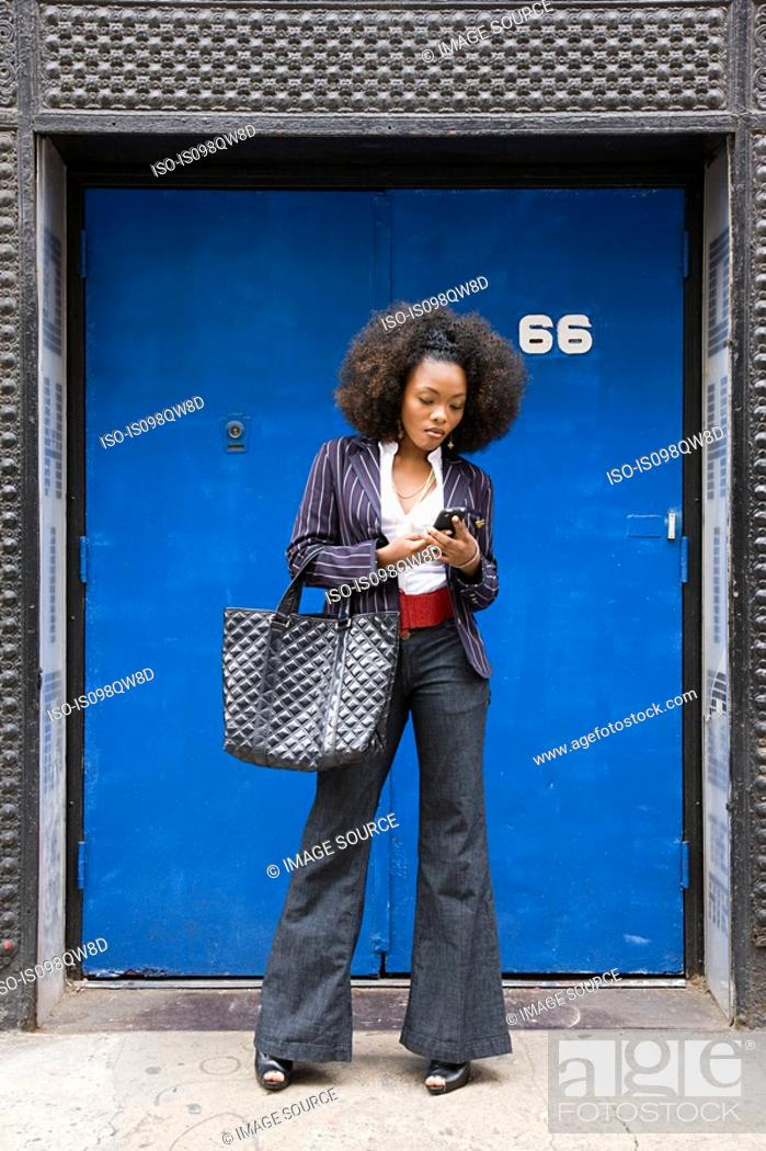 Stock Photo: Stylish woman with cellphone.