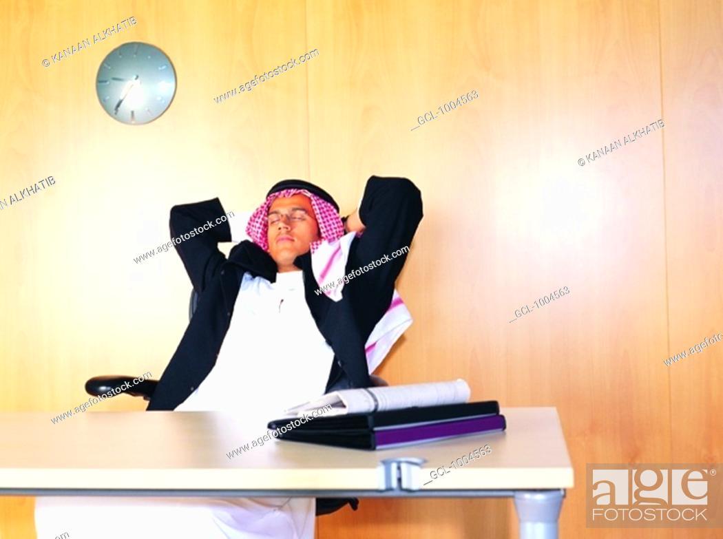 Stock Photo: Saudi Arabian businessman sleeping in the office.