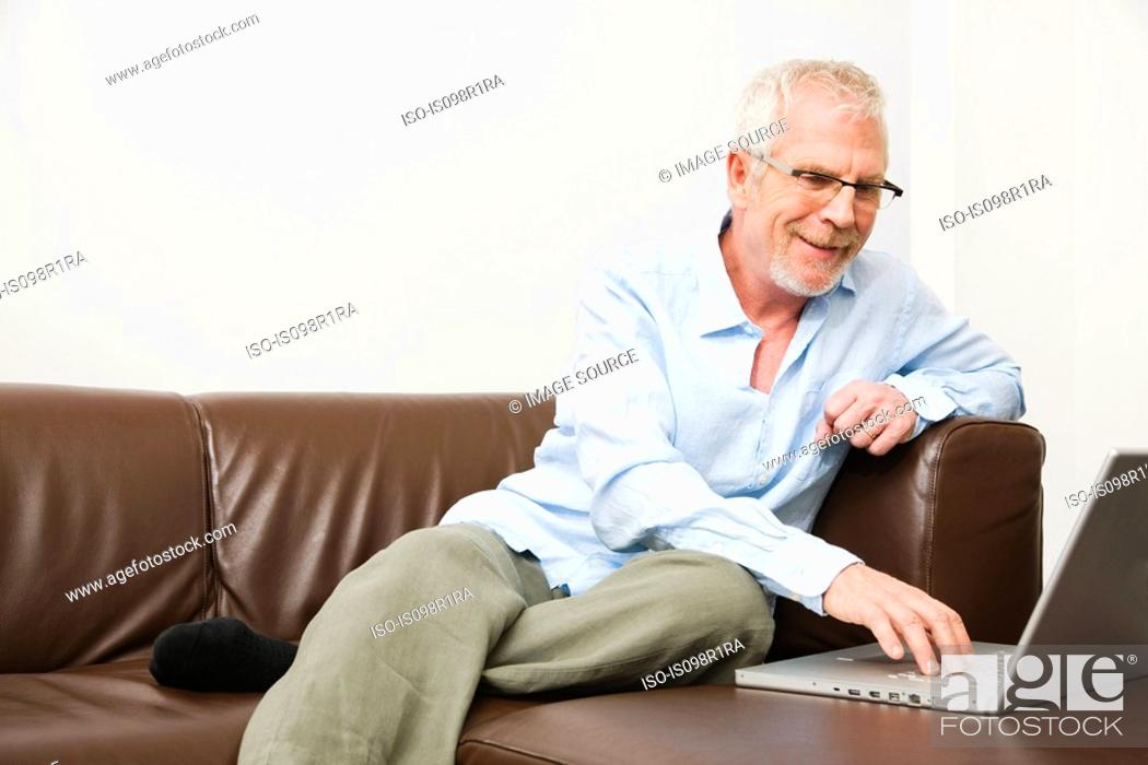 Stock Photo: Mature man using laptop.